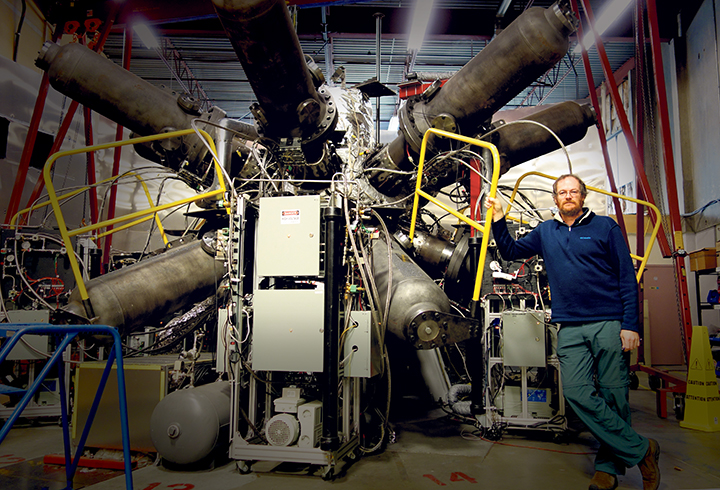 Michel Laberge standing in front of Fusion Reactor
